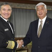 U.S. Navy Adm. Harry B. Harris Jr., commander of the United States Pacific Command, poses with Japanese Defense Minister Gen Nakatani prior to their meeting at the Defense Ministry in Tokyo on Feb. 17. | AP