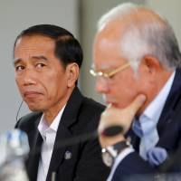 Indonesian President Joko Widodo listens as U.S. President Barack Obama addresses the 10-nation Association of Southeast Asian Nations summit in Rancho Mirage, California, on Monday. | REUTERS