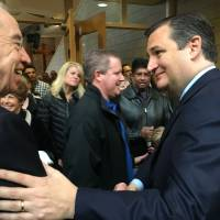 U.S. presidential candidate Sen. Ted Cruz (right) greets fellow Sen. Chuck Grassley of Iowa following a Sunday worship service at the Lutheran Church of Hope, in West Des Moines, Iowa. With just one day before the Iowa caucuses, which kick off the presidential nominating contests, Cruz is meticulously courting evangelical voters. | AFP-JIJI