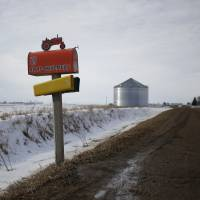 A mailbox stands along a dirt road in Boone, Iowa, on Saturday. As the first in the nation Iowa caucuses approaches, where registering your vote isn't as simple as casting a ballot, the state is starting to thrum with nervous energy. | BLOOMBERG