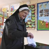 Sister Anastasia of the Franciscan order votes on Friday in Knock, Ireland. | REUTERS