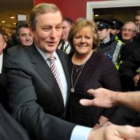 Irish Prime Minister Enda Kenny and his wife, Fionnuala, arrive at the general election count center in Castlebar on Saturday.   REUTERS