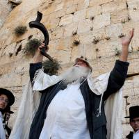 Orthodox Jews attend a slichot prayer service at the Western Wall in Jerusalem during the Days of Repentance preceding the festival of Yom Kippur. | ISRAEL GOVERNMENT PRESS OFFICE / CC-BY-SA-3.0