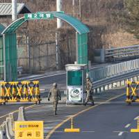 South Korean Army soldiers patrol at the customs, immigration and quarantine office near the border village of Panmunjom in Paju, South Korea on Thursday. South Korea said Wednesday that it will shut down a joint industrial park with North Korea in response to its recent rocket launch, accusing the North of using hard currency from the park to develop its nuclear and missile programs. | AP