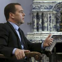 Russian Prime Minister Dmitry Medvedev speaks during an interview at the Gorki state residence outside Moscow Thursday. Medvedev raised the spectre of a permanent or a world war if powers failed to negotiate an end to the conflict in Syria and warned against any ground operations by U.S. and Arab forces. | EKATERINA SHTUKINA / SPUTNIK / POOL / REUTERS