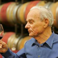 Peter Mondavi samples a glass of Cabernet Sauvignon out of the barrel at the Charles Krug Winery in St. Helena, California in 2005. On Monday, a winery board member said Mondavi, a wine country innovator who led his family's Charles Krug Winery through more than a half-century of change, died Saturday. He was 101. | AP