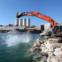 Employees work at strengthening the Mosul Dam in northern Iraq on Feb. 3. | REUTERS