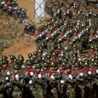 Ta'ang National Liberation Army officers march during a function to mark the 52nd Ta'ang revolution day in Mar-Wong, Ta'ang self-governing area, in Myanmar's northern Shan state, in January 2015. | AP