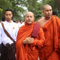 Nationalist Buddhist monk Wirathu (center) marches in Mandalay, the second-largest city in Myanmar, in September. | AP