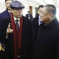 Wu Dawei (center), China's special representative for Korean affairs, talks with Pak Song Il (right), the North Korean Foreign Ministry's deputy director of the America department, upon his arrival at Pyongyang airport on Tuesday. | AP