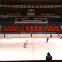 North Koreans play ice hockey in Pyongyang in this undated handout photo. | MICHAEL SPAVOR