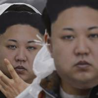 North Korean defectors wearing masks of the country's leader, Kim Jong Un, attend a rally Friday in Seoul against Pyongyang's rocket launch and nuclear test. | AP