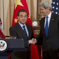 U.S. Secretary of State John Kerry (right) and Chinese Foreign Minister Wang Yi hold a press conference at the State Department in Washington, D.C., Tuesday, after the two sides made progress toward agreeing on a United Nations sanctions resolution to punish North Korea for its recent nuclear tests, the powers' top diplomats said. An agreement was reached Wednesday, envoys said. | AFP-JIJI