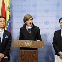 Motohide Yoshikawa (left), Japan's ambassador to the United Nations, and South Korean Ambassador Oh Joon (right) listen as Samantha Power, the U.S. ambassador, makes comments to the media following a Security Council meeting at U.N. headquarters, Sunday. The council is meeting about North Korea's successful launch of a long-range missile. | AP