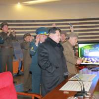 North Korean leader Kim Jong Un reacts as he watches a long range rocket launch in this undated photo released by North Korea's Korean Central News Agency (KCNA) in Pyongyang Sunday. | KCNA / REUTERS
