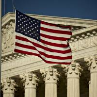 The American flag flies at half-staff in front of the U.S. Supreme Court building in Washington, D.C., Tuesday. Justice Antonin Scalia's unexpected death, and Senate Republicans' refusal to confirm a successor while President Barack Obama is in office, threatens to ignite a year-long battle over the court's future. | BLOOMBERG