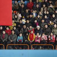 North Koreans sit behind a banner with an exclamation mark during a figure skating performance held Tuesday as part of celebrations on the 'Day of the Shining Star' or birthday anniversary of late North Korean leader Kim Jong Il in Pyongyang. While the rest of the world was focusing its attention on North Korea's recent nuclear test and rocket launch, the country's ruling party announced a slew of new slogans Thursday intended to guide and inspire the nation ahead of a once-in-a-generation party congress scheduled for May. Judging from the number of exclamation marks, it appears they have a lot of work to do. | AP