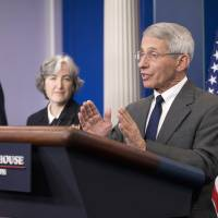 White House Press secretary Josh Earnest and Dr. Anne Schuchat, principal deputy director of the CDC, listen as Dr. Anthony Fauci, director of NIH/NIAID, answers questions from the media during the daily briefing in the Brady Press Briefing Room of the White House Monday. | AP