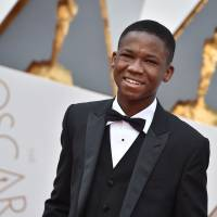 Abraham Attah arrives at the Oscars on Sunday at the Dolby Theatre in Los Angeles. | JORDAN STRAUSS/INVISION/AP