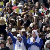 People participate in a Mass celebrated by Pope Francis for a crowd of hundreds of thousands in Ecatepec, Mexico, Sunday. | REUTERS
