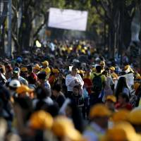 People wait for the arrival of Pope Francis at an event in Mexico City on Saturday. On Sunday he was to celebrate Mass in a district known for murder, rape and other gang-related violence. | REUTERS