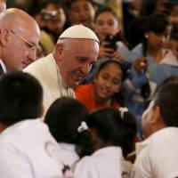 Pope Francis greets children at the cathedral in Morelia, Mexico, Tuesday.   REUTERS