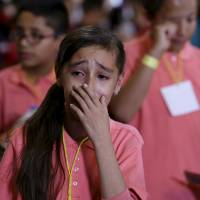 A young girl is overcome with emotion after greeting Pope Francis at the cathedral in Morelia, Mexico, Tuesday.   REUTERS
