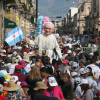 Faithful carry an image of Pope Francis in Morelia, Michoacan state, Mexico, Tuesday. Francis urged Mexican priests and nuns on Tuesday to not despair in the face of violence as he visited a former bastion of a cult-like drug cartel.   AFP-JIJI