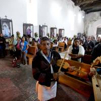 A Tzotzil Indian man plays a violin during a Jan. 17 Mass at the San Pedro Catholic Church, in Chenalho, Chiapas state, Mexico. Pope Francis' Feb. 12-18 Mexico trip includes a one-day visit to Chiapas, where he will celebrate Mass and lunch with indigenous people. | AP