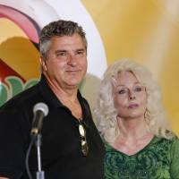 Lottery winners David Kaltschmidt and Maureen Smith talk to reporters in Melbourne Beach, Florida, on Wednesday. | REUTERS
