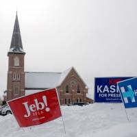 New Hampshire primary voters look to favor insurgents Trump, Sanders