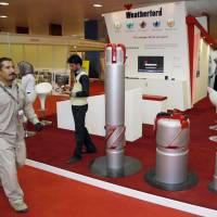 A security guard walks past the Weatherford booth during the Basra International trade fair for oil and gas in Basra, Iraq in 2010. Iraq is searching for 'highly dangerous' radioactive material stolen last year, according to an environment ministry document and seven security, environmental and provincial officials who fear it could be used as a weapon if acquired by Islamic State. | REUTERS