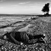 This Jan. 25 image provided by the India Today news magazine shows Chinese artist and activist Ai Weiwei posing as he lies face down on the beach on the Greek island of Lesbos. Chinese artist Ai Weiwei has re-created the famous image of a 3-year-old Syrian child who drowned in Turkey last year by staging a photo of himself lying face down. | ROHIT CHAWLA / INDIA TODAY VIA AP
