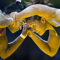 Cuba's gold medalist, Lisette Hechevarria (left) competes with Brazil's Aline Ferreira da Silva, also known as Aline Silva, during the women's wrestling Greco-Roman 72 kg at the Pan American Games in Guadalajara, Mexico, in 2011. Silva has had the dengue fever twice, and said she's not taking any chances with the Zika virus. 'For me it's very worrying,' said Silva, who said she applies repellent about every 90 minutes when she's away from home. | AP