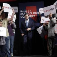 Republican presidential candidate Sen. Marco Rubio walks up to the stage at a rally Monday in Reno, Nevada. | AP