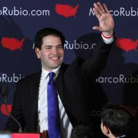 Republican presidential candidate Sen. Marco Rubio acknowledges the crowd in Manchester, New Hampshire, on Tuesday. | AP