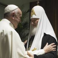 Pope Francis embraces Patriarch Kirill after signing a joint declaration on religious unity at Jose Marti International Airport in Havana on Friday. | REUTERS