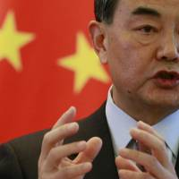 Chinese Foreign Minister Wang Yi speaks at a joint news conference with Australian Foreign Minister Julie Bishop at the Ministry of Foreign Affairs in Beijing on Wednesday. | REUTERS