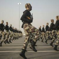 Security forces take part in a military parade in preparation for the annual hajj pilgrimage in Mecca, Saudi Arabia, last September.   AP