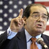 U.S. Supreme Court Justice Antonin Scalia speaks to Presbyterian Christian High School students in Hattiesburg, Mississippi, in April 2004. On Saturday, the U.S. Marshall's Service confirmed that Scalia had died at the age of 79. | GAVIN AVERILL / THE HATTIESBURG AMERICAN / AP