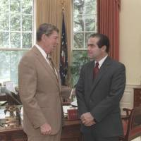 U.S. President Ronald Reagan speaks with Supreme Court Justice nominee Antonin Scalia in the White House Oval Office in Washington in July 1986. | BILL FITZ-PATRICK / WHITE HOUSE / RONALD REAGAN LIBRARY / REUTERS