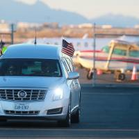 The hearse that transported Supreme Court Justice Antonin Scalia's body is seen at El Paso International Airport in El Paso, Texas, on Sunday. | AP