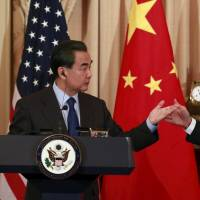 U.S. Secretary of State John Kerry and Chinese Foreign Minister Wang Yi hold a joint news conference after meeting at the State Department in Washington on Tuesday. | REUTERS