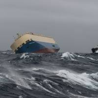 Amid 6-meter waves, experts try to salvage listing freighter adrift off France
