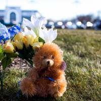 A makeshift memorial is seen near where people were shot near a car dealership Sunday in Kalamazoo, Michigan. According to police a man drove around Kalamazoo fatally shooting several people at multiple locations on Saturday. Authorities identified the shooter as Jason Dalton. | ANDRAYA CROFT / DETROIT FREE PRESS VIA AP
