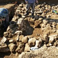 This handout photo released by the Israel Antiquities Authority on Wednesday shows work at the site of the oldest settlement yet discovered in Jerusalem. | AP