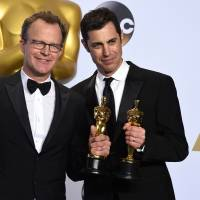 Tom McCarthy, left, and Josh Singer pose with the award for best original screenplay for 'Spotlight' on Sunday evening in the Oscars press room. | JORDAN STRAUSS/INVISION/AP