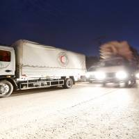 A Syrian Arab Red Crescent aid convoy waits to enter the town of Madaya, near Damascus, on Wednesday. | REUTERS