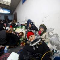 Internally displaced Syrians are seen at a shelter near the Bab al-Salam crossing, across from Turkey's Kilis province, on the outskirts of the northern border town of Azaz, Syria, Saturday. | REUTERS