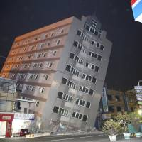 A building leans precariously after a large earthquake struck the area near Tainan, Taiwan, early Saturday. | REUTERS